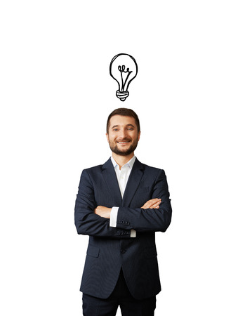 above head: successful young businessman with light bulb above the head over white
