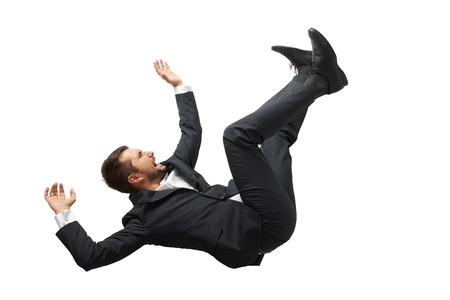 Caduta e urlando uomo d'affari in abbigliamento formale su sfondo bianco Archivio Fotografico - 31272381