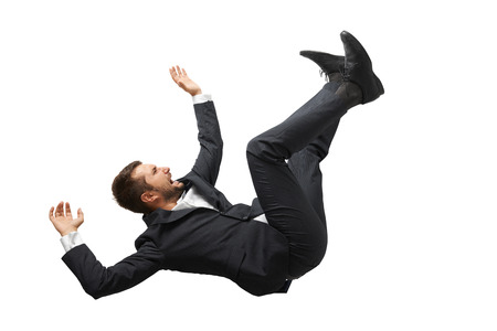 downward: falling and screaming businessman in formal wear over white background