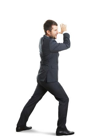 striding: screaming businessman striding over white background