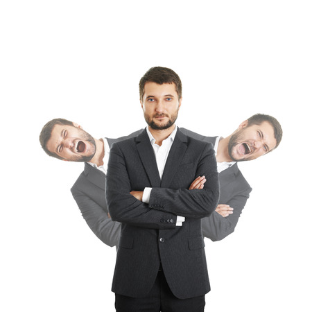 sure: two screaming men behind sure businessman in suit. isolated on white background Stock Photo