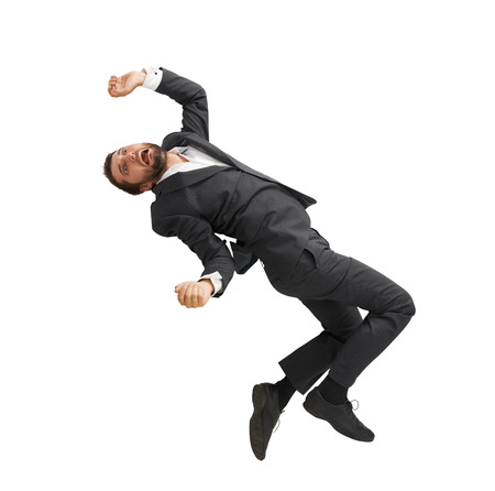 tumble down: frightened businessman falling down and screaming. isolated on white background