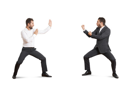two funny fighters in forman wear over white background photo