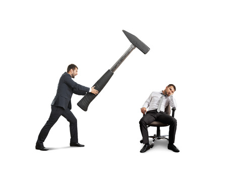 angry boss in the suit holding big hammer and screaming at lazy worker. isolated on white background photo