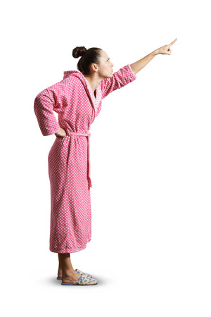 house wife: strict housewife pointing up. isolated on white background Stock Photo