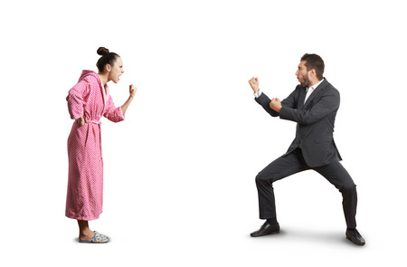 fight between angry wife and emotional husband. isolated on white background Foto de archivo