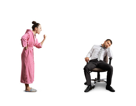 lazybones: angry wife screaming at lazy husband. isolated on white background