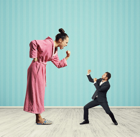 henpecked: quarrel between emotional woman and small man