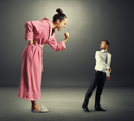 henpecked: angry screaming woman shouting at small scared man