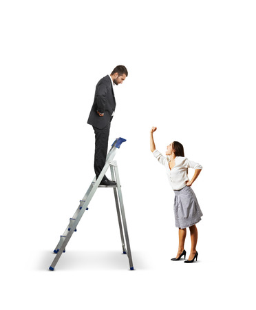 displeased businessman: displeased woman screaming and showing her fist at businessman on stepladder. isolated on white background