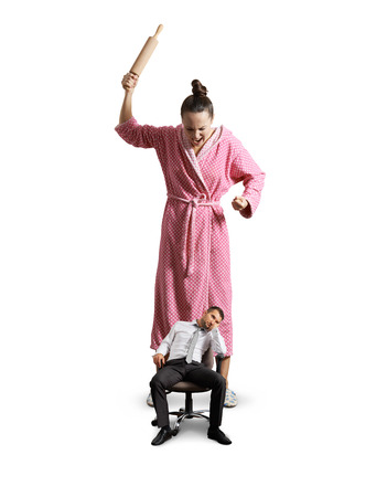 lazybones: displeased housewife screaming at her lazy husband. isolated on white background