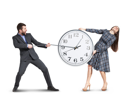 emotional couple stretching out the clock. isolated on white background photo