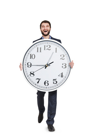 laughing man walking with big clock. isolated on white background photo