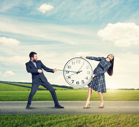emotional couple with clock at outdoor photo