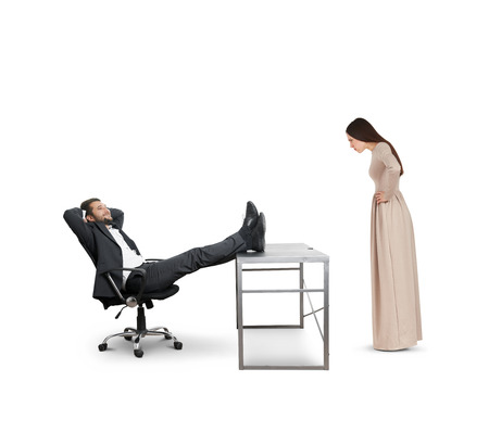 fatigued: strict woman looking at smiley lazy man on chair. isolated on white background