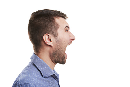 sideview of young man with open mouth. isolated on white background