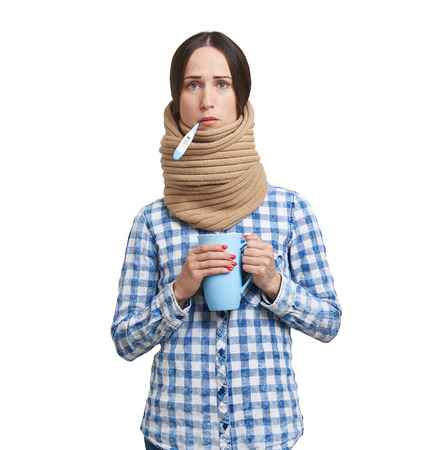 afflict: sad woman with thermometer in scarf have a flu. isolated on white background Stock Photo