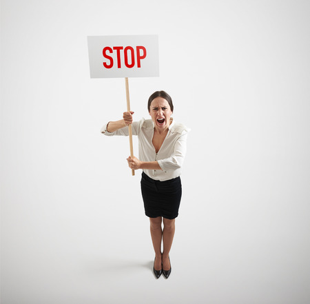 remonstrance: view from above of screaming businesswoman holding placard with stop sign over light grey background