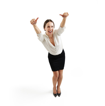 view from above of laughing businesswoman in formal wear with thumbs up over light grey background 版權商用圖片