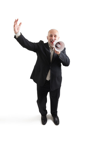 joyous: top view of joyous senior businessman with megaphone looking at camera and screaming. isolated on white background