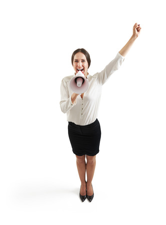 hand wear: view from above of happy businesswoman in formal wear screaming at megaphone and raising up one hand. isolated on white background Stock Photo