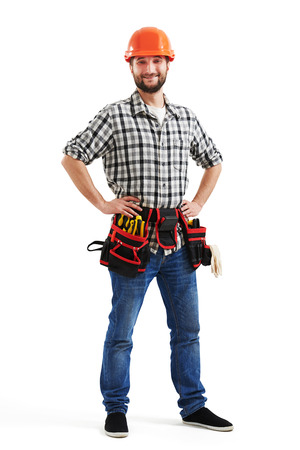 tools belt: smiley workman in orange hard hat and belt with tools. isolated on white background Stock Photo
