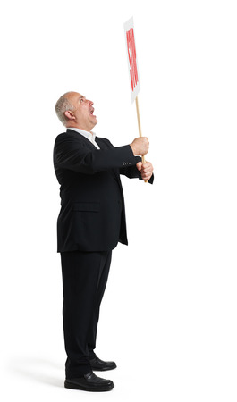 remonstrance: sideview of screaming senior businessman holding placard with stop sign. isolated on white background
