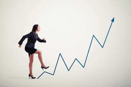 purposeful: purposeful woman walking up diagram blue arrow over light grey background Stock Photo
