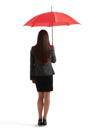long red hair woman: back view of woman in formal wear under red umbrella. isolated on white background