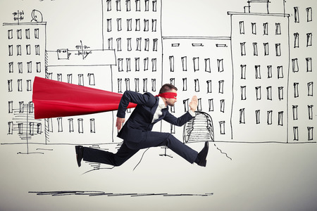serious businessman wearing like superhero very fast running in drawing street