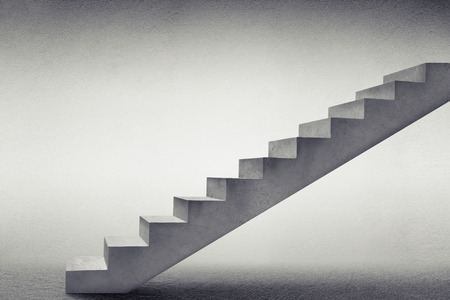 ladder: concrete stairs in grey empty room Stock Photo