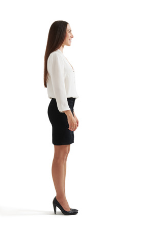 sideview: full-length sideview portrait of businesswoman in formal wear. isolated on white background Stock Photo