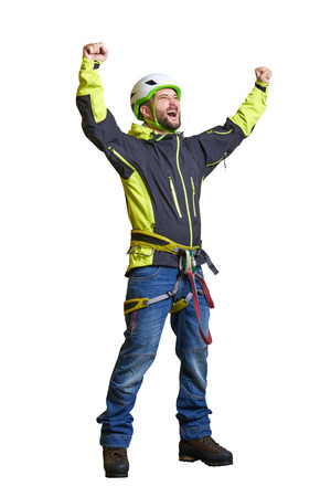 alpinist: happy tourist in helmet and alpinist equipment raising his hands up and screaming. isolated on white background Stock Photo