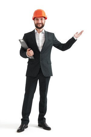 hand wear: successful businessman in formal wear and orange helmet pointing his hand at something. isolated on white background