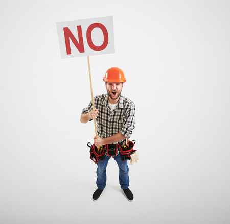 remonstrance: displeased screaming handyman holding no sign isolated on light grey background