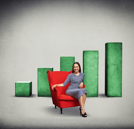 red chair: smiley woman sitting on the red chair over green positive diagram