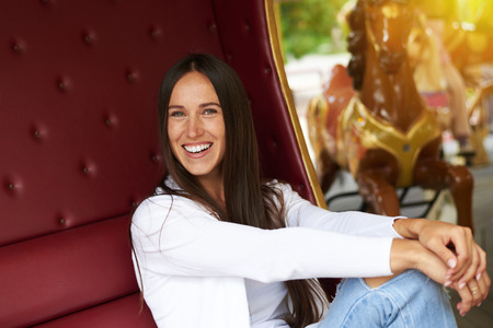 merriment: laughing woman having fun in merry-go-round Stock Photo