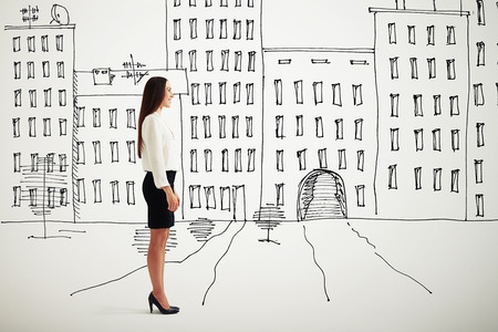 sideview: sideview of smiley woman in formal wear over drawing cityscape