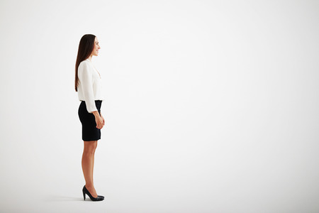 sideview: sideview of smiley businesswoman over light grey background