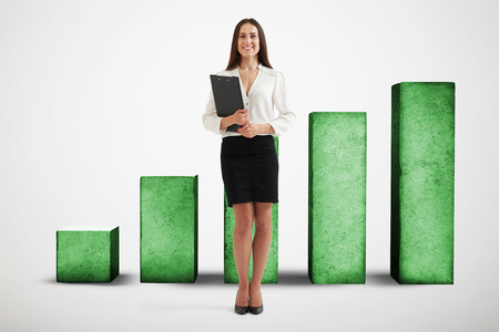 smiley businesswoman in formal wear holding black folder and standing over positive diagram