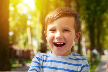 child portrait: outdoor portrait of laughing pretty boy