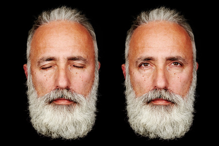 two men: two faces of senior bearded man over black background