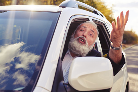 discontented: discontented man shouting from the window of his car