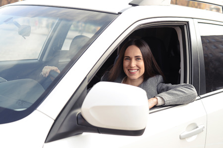 alluring: alluring young woman driving a car and looking at camera Stock Photo
