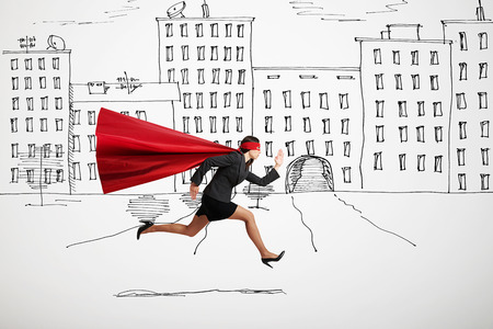 cape: serious businesswoman wearing like superhero very fast running in drawn street