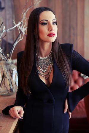 femme noire nue: portrait of glamour woman in black dress