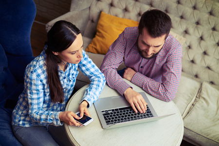 business casual: top view on young couple using laptop