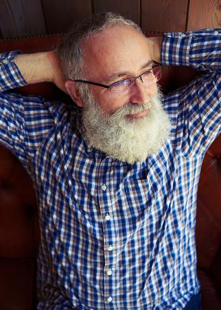 old man beard: portrait of smiley senior man in glasses Stock Photo