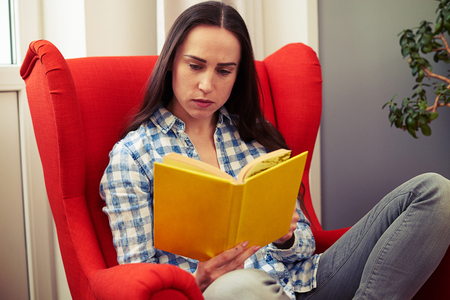 woman resting: woman resting on the chair with book Stock Photo