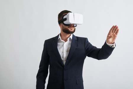formal wear: Close up of businessman in a formal wear and virtual reality glasses